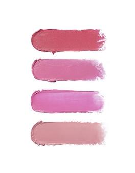 Pociągnięcia pędzlem szminka w różnych odcieniach na białym tle