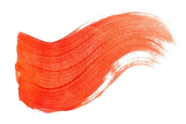 Pociągnięcie pędzlem czerwonej farby. błyszczące złoto streszczenie teksturowane