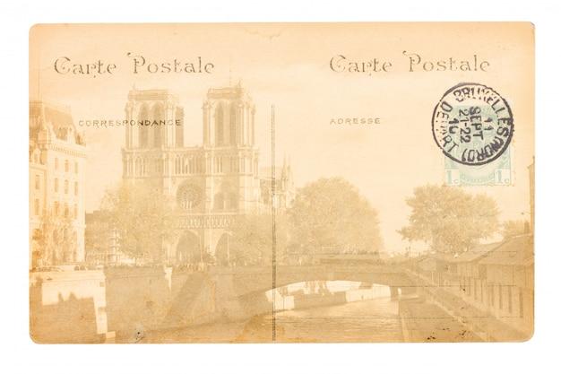 Pocztówka starego paryża z kościołem katedralnym notre dame.
