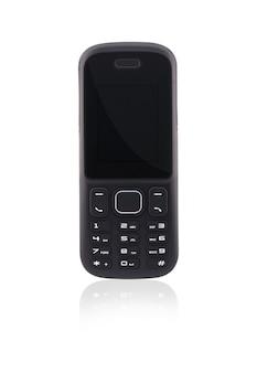 Pod różnymi kątami przyciskowy telefon komórkowy na białym tle z odbiciem
