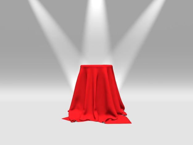 Podium lub platforma pokryta czerwoną tkaniną oświetloną reflektorami