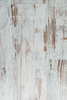 Podławy biały drewniany tło. grunge wyblakły powierzchni. pionowy