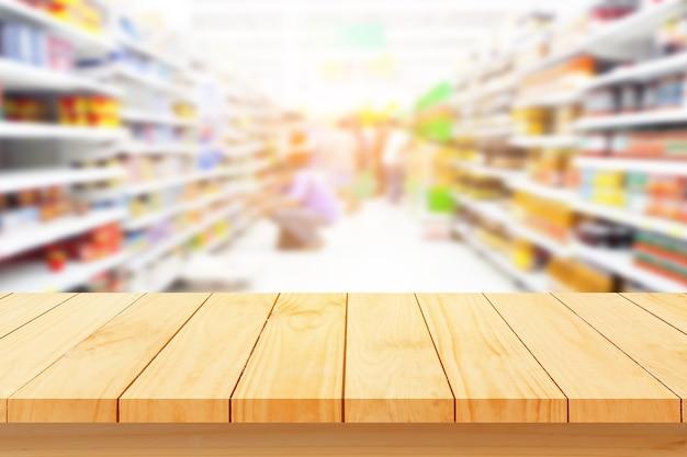 Podłoga z drewna i supermarket rozmycie tła