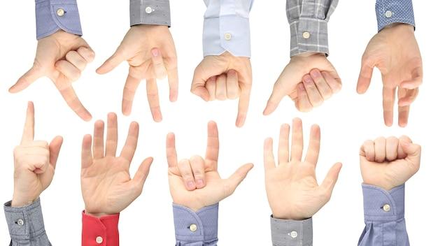 Podniesione ręce różnych mężczyzn na białym tle