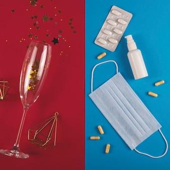 Podzielona koncepcja bożego narodzenia podczas pandemii. szampan i święto lub wirus i leczenie