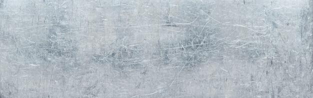 Pogniecione metalowe tło, faktura uszkodzonej stali nierdzewnej lub aluminium (głowica strony)