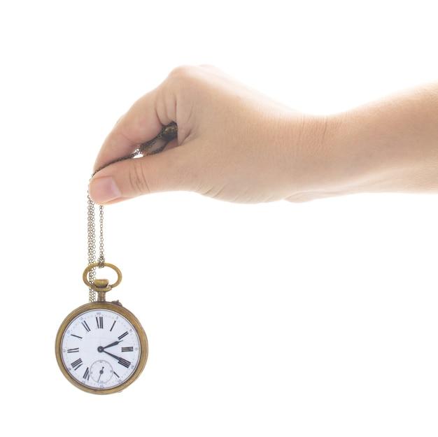 Pojęcie czasu - czyjaś ręka trzyma antyczny stary zegar na białym tle