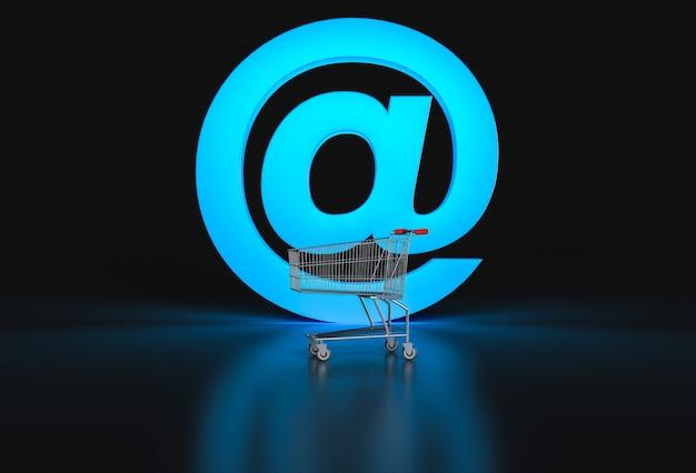 Pojęcie e-commerce. duży znak @ i pusty koszyk na czarno. renderowania 3d