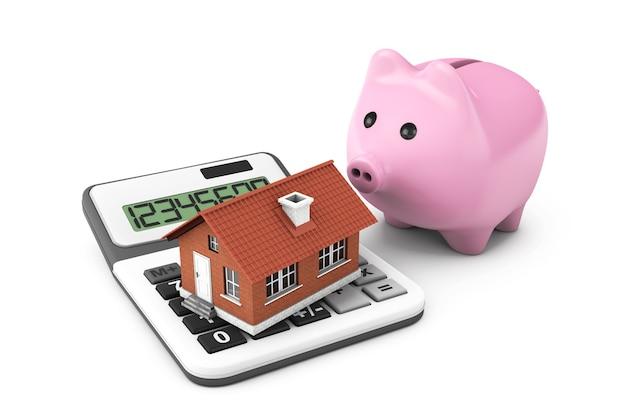 Pojęcie nieruchomości. dom z kalkulatorem i skarbonką na białym tle