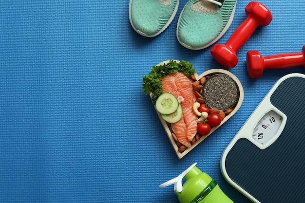 Pojęcie zdrowego stylu życia na tle mata fitness