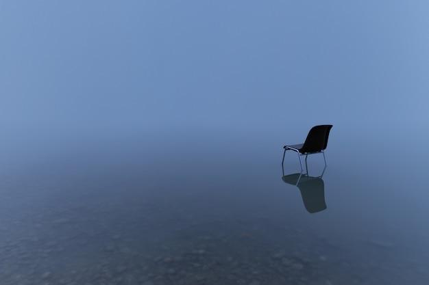 Pojedyncze krzesło odbijające się na tafli wody w burzliwy dzień