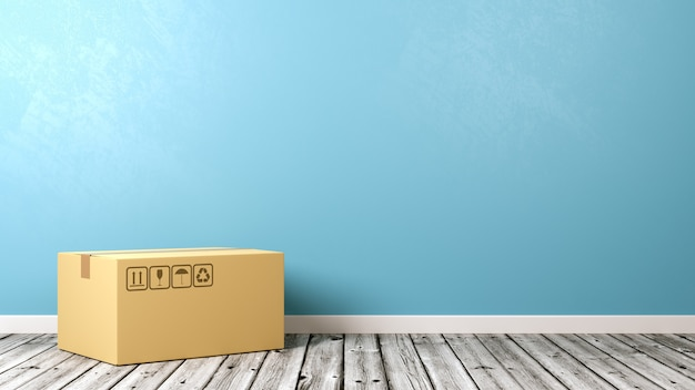 Pojedyncze zamknięte pudełko kartonowe na drewnianej podłodze przy ścianie