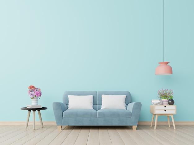 Pokój dzienny z niebieską ścianą i niebieską kanapą.