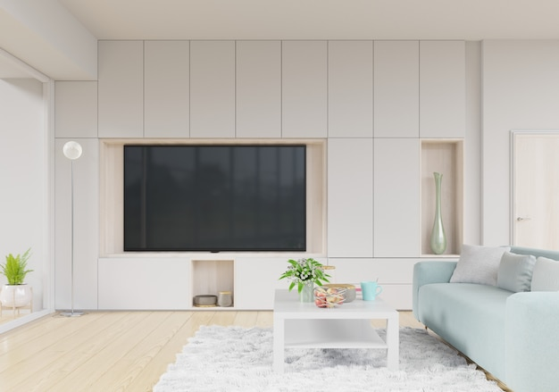 Pokój dzienny z telewizorem, kanapą ze stołem na dywanie i półkami