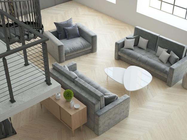 Pokój na poddaszu z wysokim sufitem z częścią wypoczynkową, szare sofy