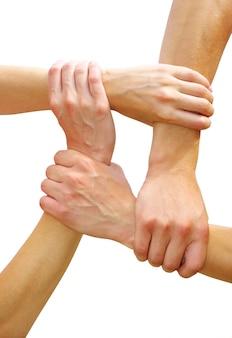 Połączone ręce na białym tle, symbolizujące pracę zespołową i przyjaźń