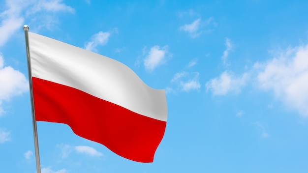 Polska flaga na słupie. niebieskie niebo. flaga narodowa polski