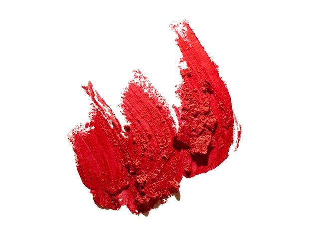 Pomadki czerwonej plamy tekstury biały odosobniony tło