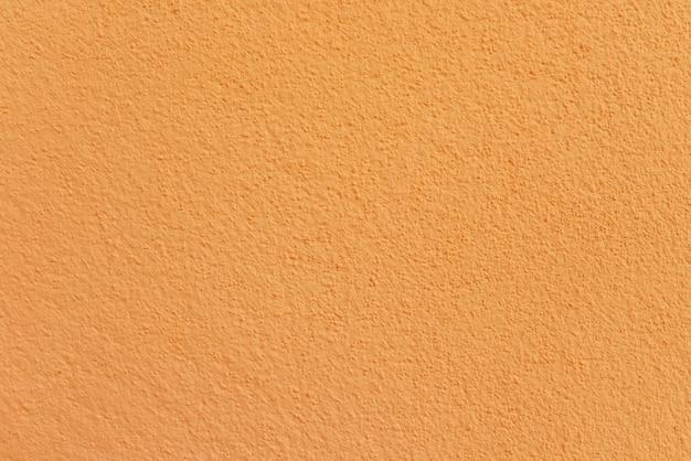 Pomarańcze cementu lub betonowej ściany tekstura dla tła
