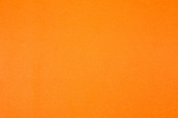 Pomarańczowa ściana tekstury papieru dla
