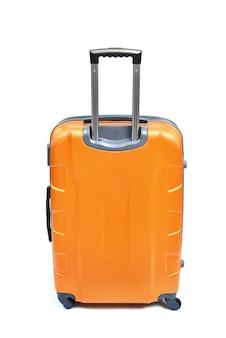 Pomarańczowa walizka odizolowywająca na bielu