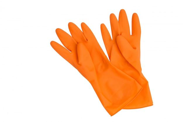 Pomarańczowe gumowe rękawiczki na białym tle
