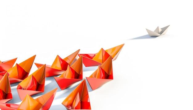 Pomarańczowe łódki z papieru podążają za białą łódką.