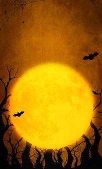 Pomarańczowe tło halloween z pełni księżyca i nietoperza