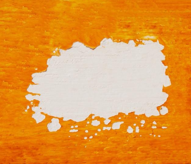 Pomarańczowe tło ściany tynku