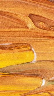 Pomarańczowe tło z błyszczącymi rozmazami. streszczenie tekstura. kreatywne pociągnięcia pędzlem złotą farbą