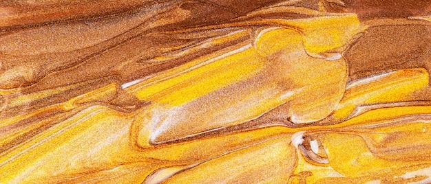 Pomarańczowo-brązowe tło z błyszczącymi rozmazami. streszczenie tekstura farby