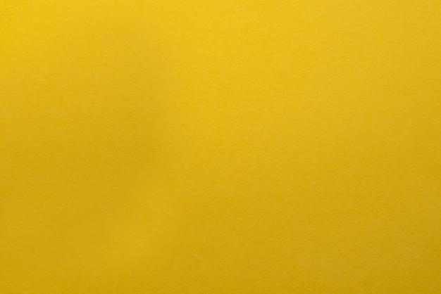 Pomarańczowo żółte tło z ciemnym tłem tekstury