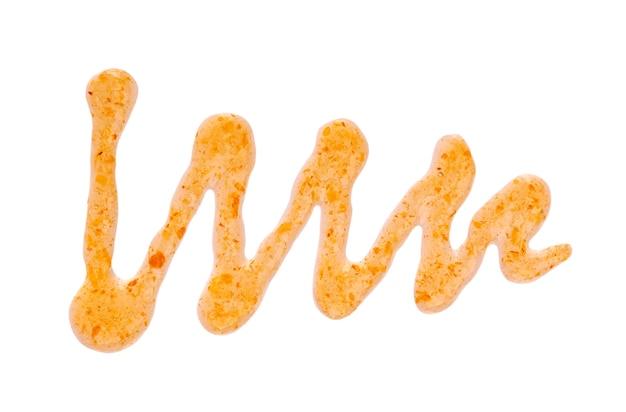 Pomarańczowy dżem gruby mżawka na białym tle