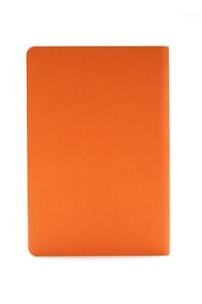 Pomarańczowy dzienniczek odizolowywający na białym tle