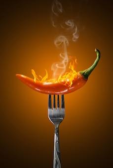 Pomarańczowy gorący chili pieprz odizolowywający