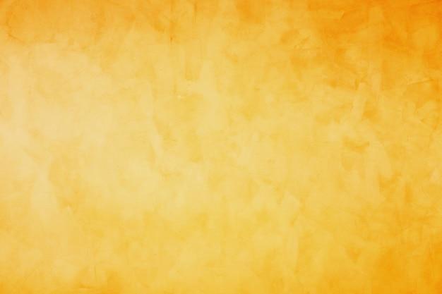 Pomarańczowy i żółty grunge cementu tło