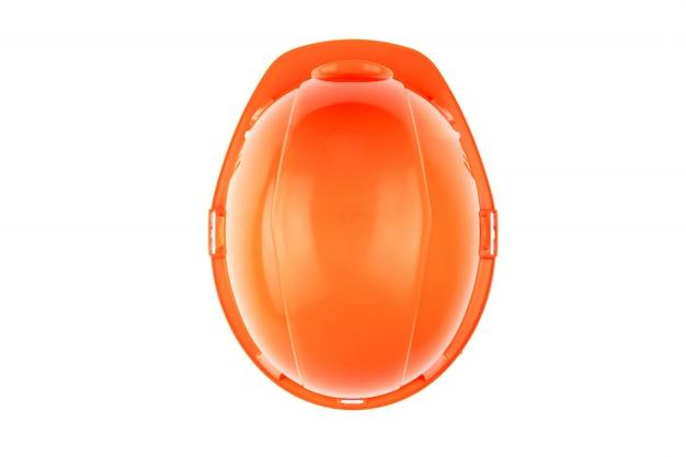 Pomarańczowy kask budowlany. pojęcie architektury, budownictwa, inżynierii, projektowania. skopiuj miejsce. widok z góry