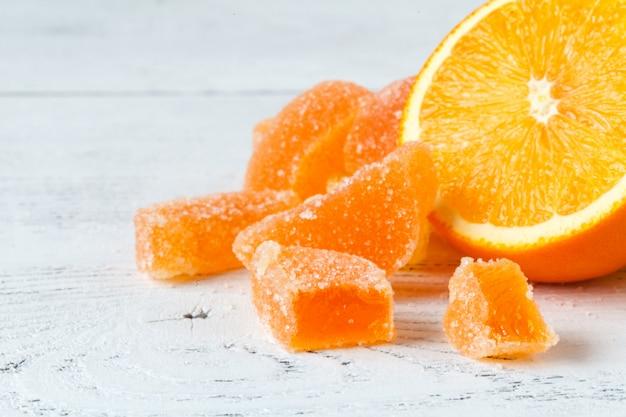 Pomarańczowy marmoladowy galaretowy zakończenie w górę widoku