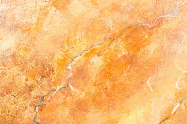 Pomarańczowy marmurowy tło
