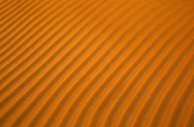 Pomarańczowy piasek pustyni tło wzór z liniami