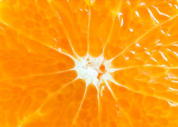 Pomarańczowy plasterka zakończenie w górę tła, pomarańczowego makro- tła i tekstury studia fotografii.