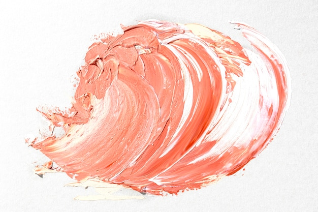 Pomarańczowy pociągnięcie pędzla na białym tle