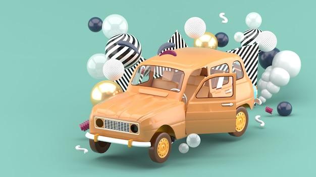 Pomarańczowy samochód wśród kolorowych kulek na niebiesko. renderowania 3d