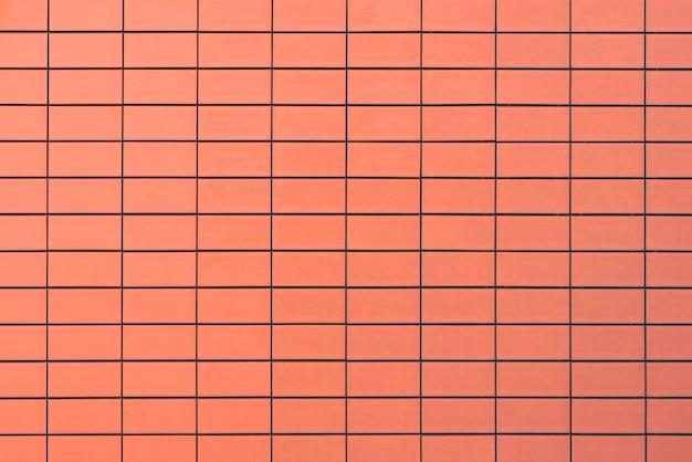 Pomarańczowy ściana z cegieł dla tła lub tekstury. pomarańczowy ściana z cegieł tekstury tło