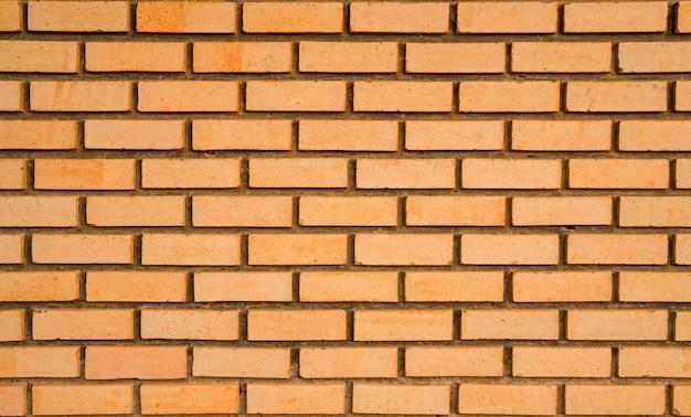 Pomarańczowy ściana z cegieł tekstury tło z przestrzenią dla teksta