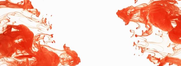 Pomarańczowy tusz rozpuszcza się w wodzie, na białym tle na białym tle. abstrakcja w ruchu, w wodzie krąży kolorowy atrament