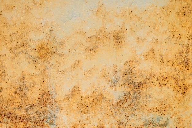 Pomarańczowy zardzewiały teksturowanej tło metalowe. kopiuj przestrzeń dla projektantów.