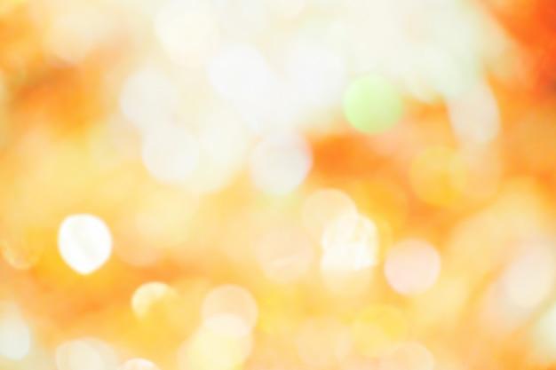 Pomarańczowy, żółty i biały bokeh światło. abstrakt lub zamazany lekki błyskotliwość. tekstura blasku b