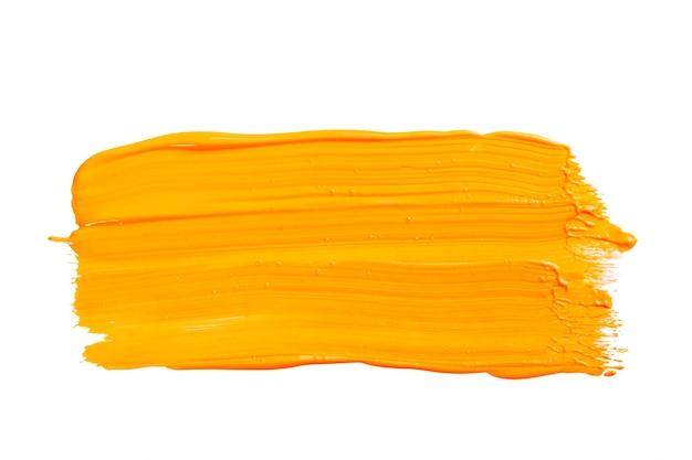 Pomarańczowy żółty pociągnięcie pędzla na białym tle.