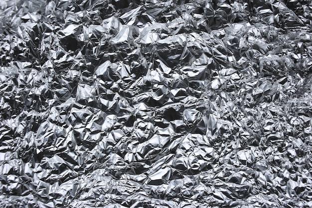 Pomarszczona folia srebrna tekstura tło